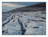 Limestone pavement stretches away to karst hills in the Burren